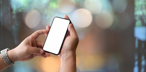 Close-Up Photo of Person Using Mobile Phone