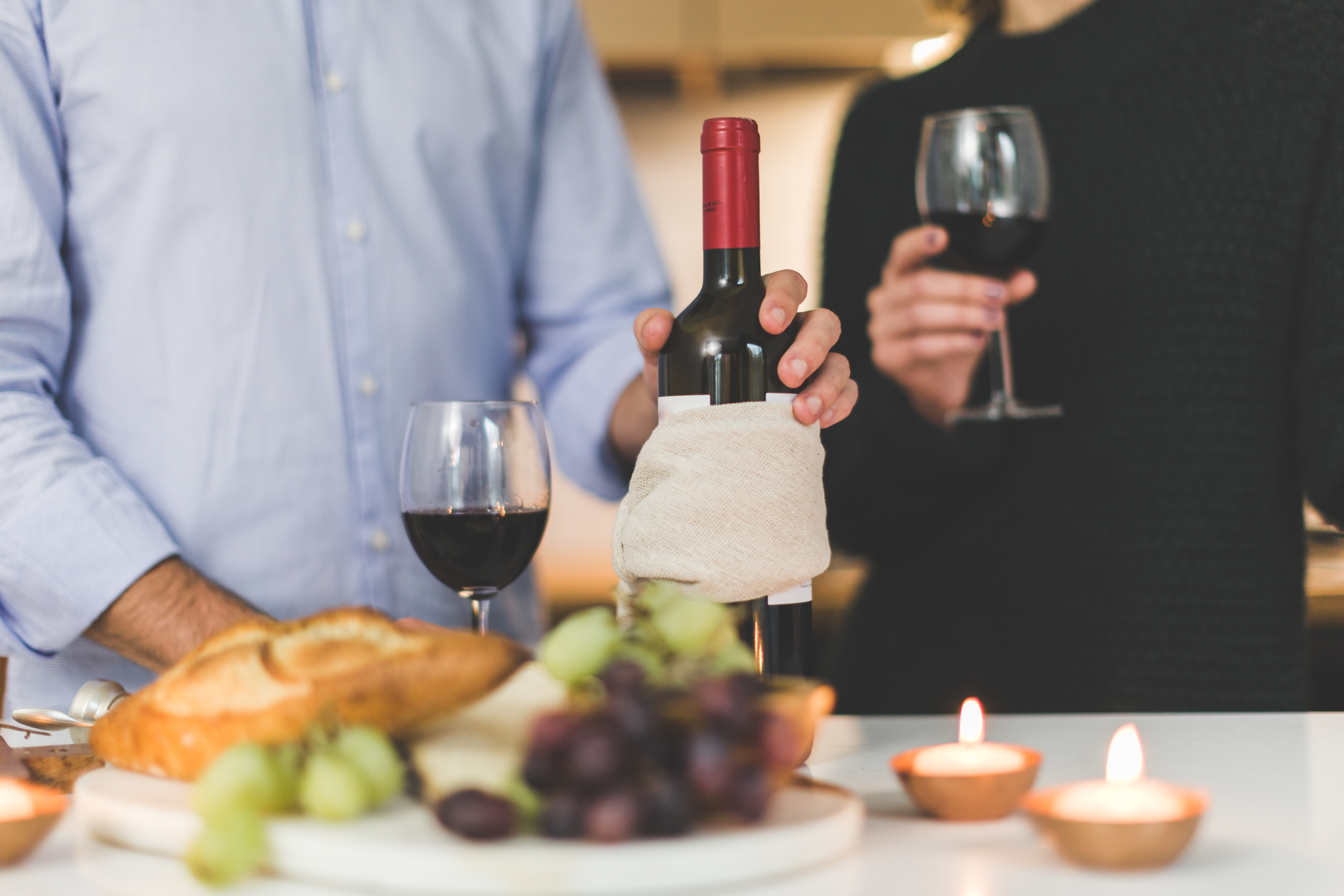Person Holding Wine Bottle