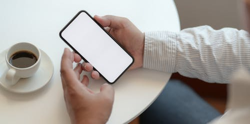 Photo of Person Using Mobile Phone