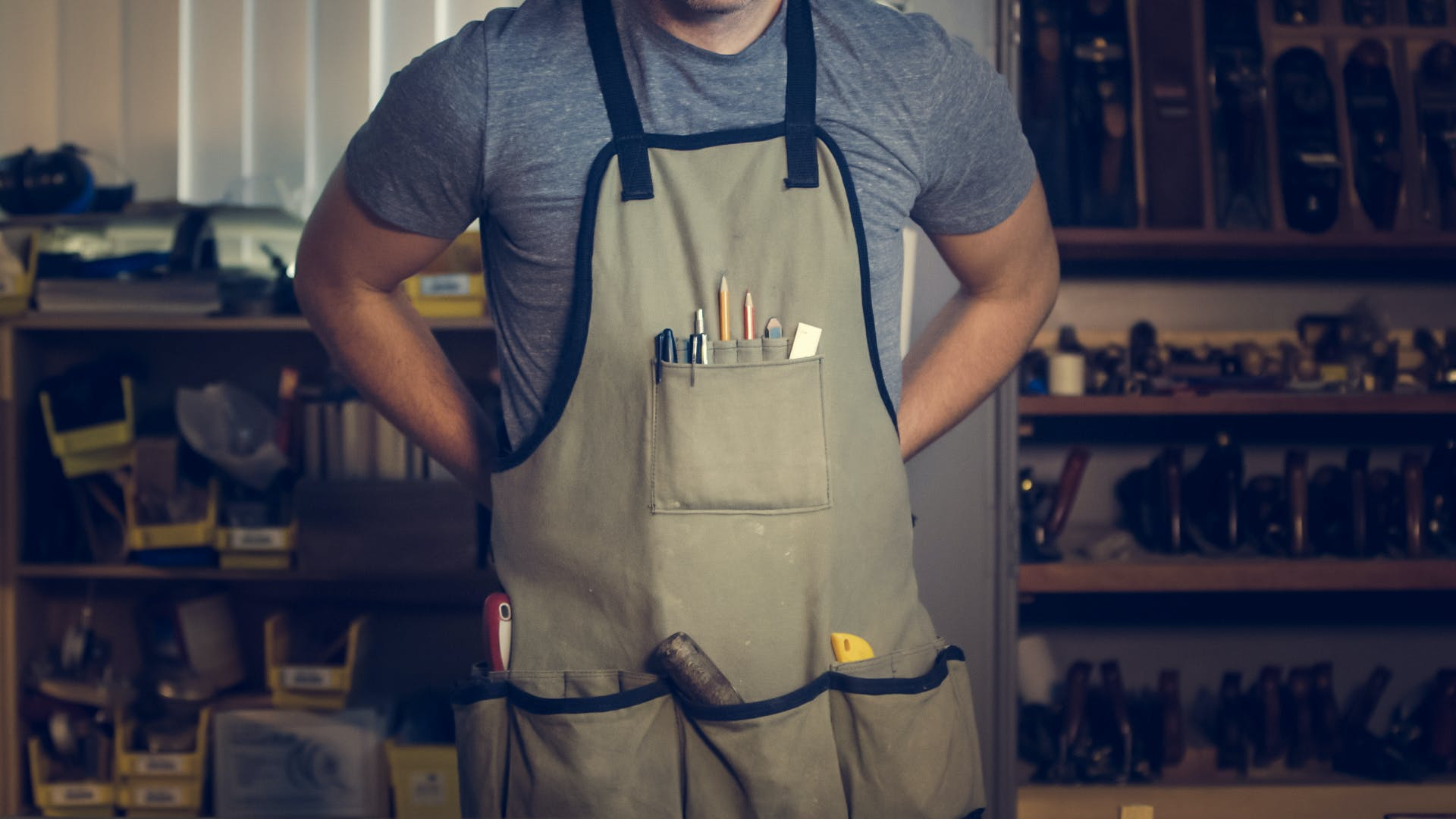 Photo of Man Wearing Gray Shirt and Apron