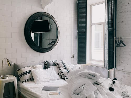White Bed Linen Near White Framed Glass Window