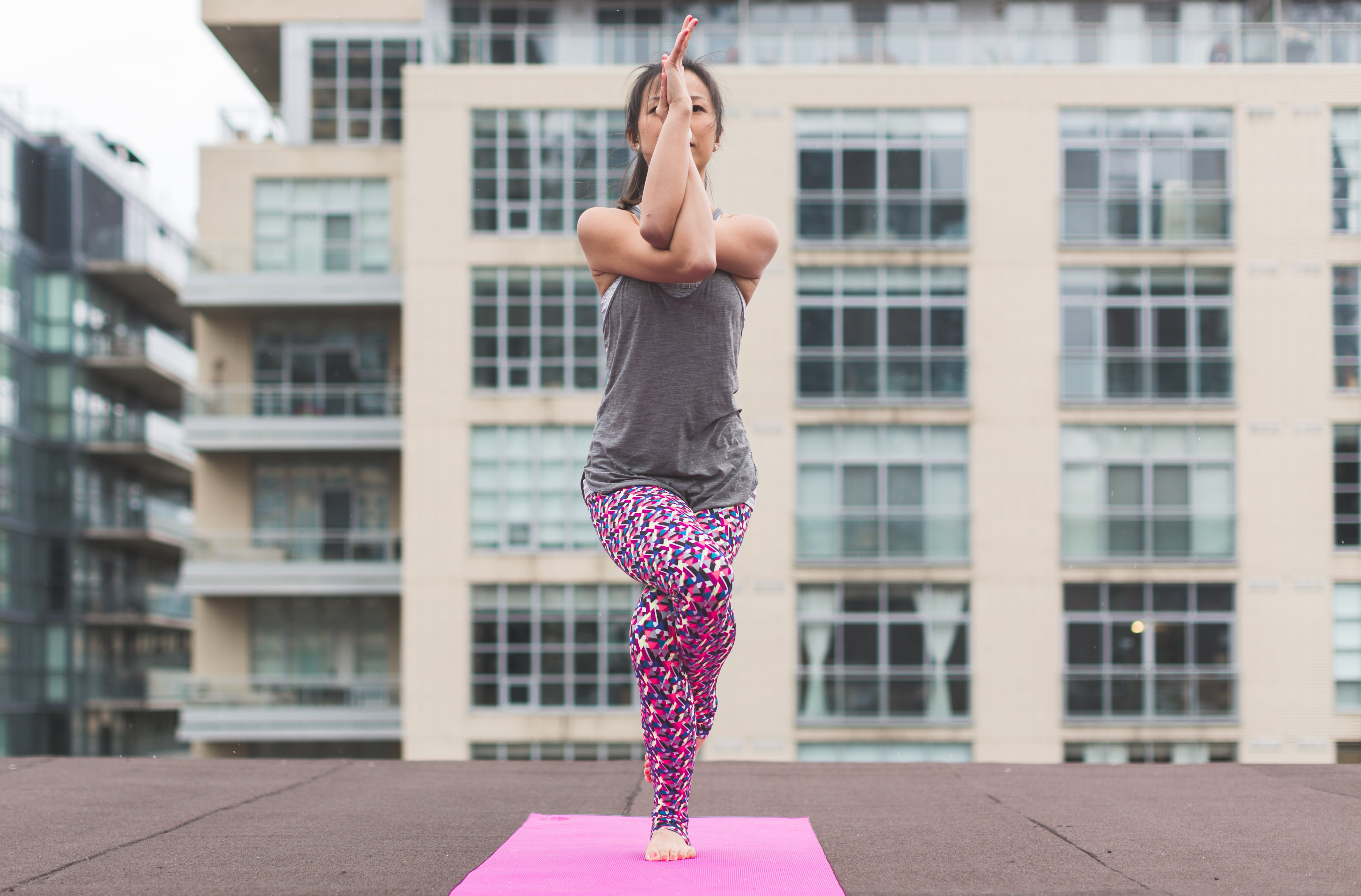 Woman in Gray Top and Pink Pants Yoga on Pink Mat