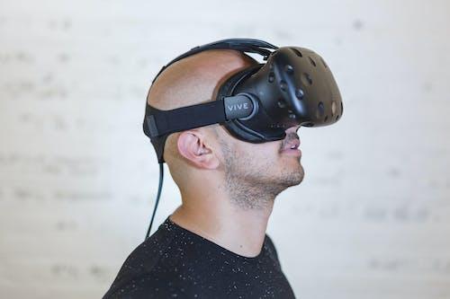 Man Wearing Black Vr Headset