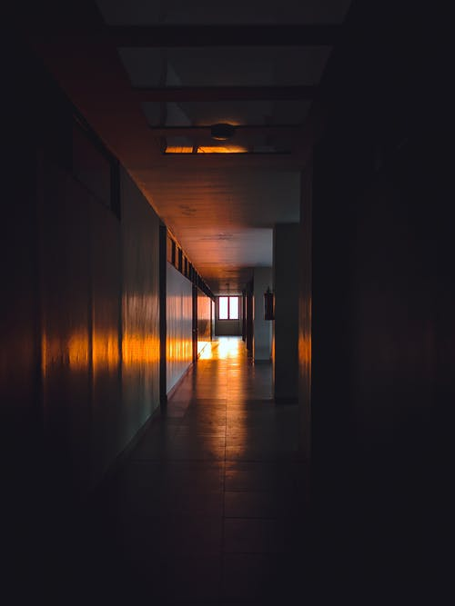 Empty dark corridor of building
