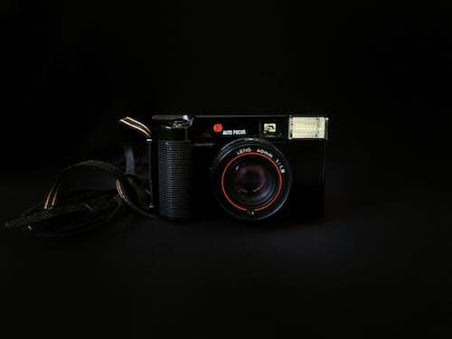 Vintage black photo camera with belt