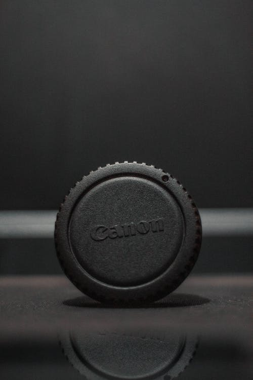 Free stock photo of canon, lens cap, product photography