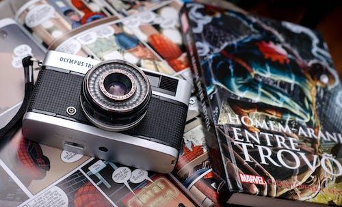 Comic books and photo camera