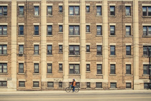 Person Biking Near Building