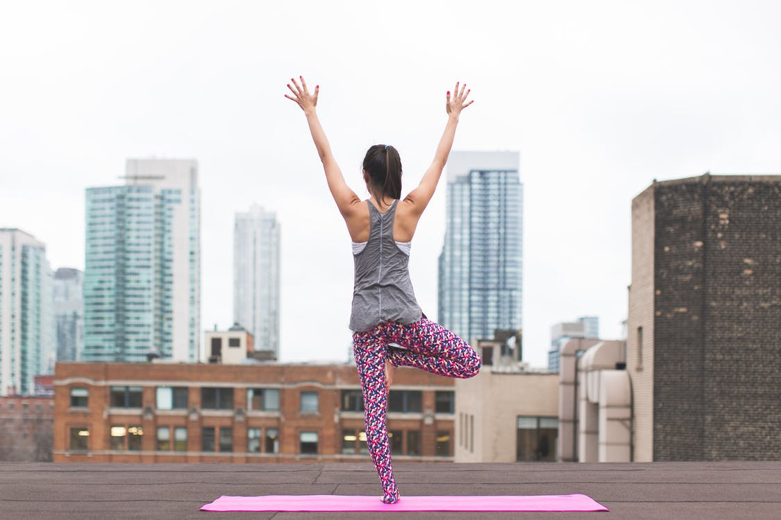 Woman Doing Yoga on Top of Building - Yoga With Adriene
