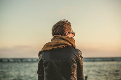 Man Wearing Black Leather Jacket during Sunset