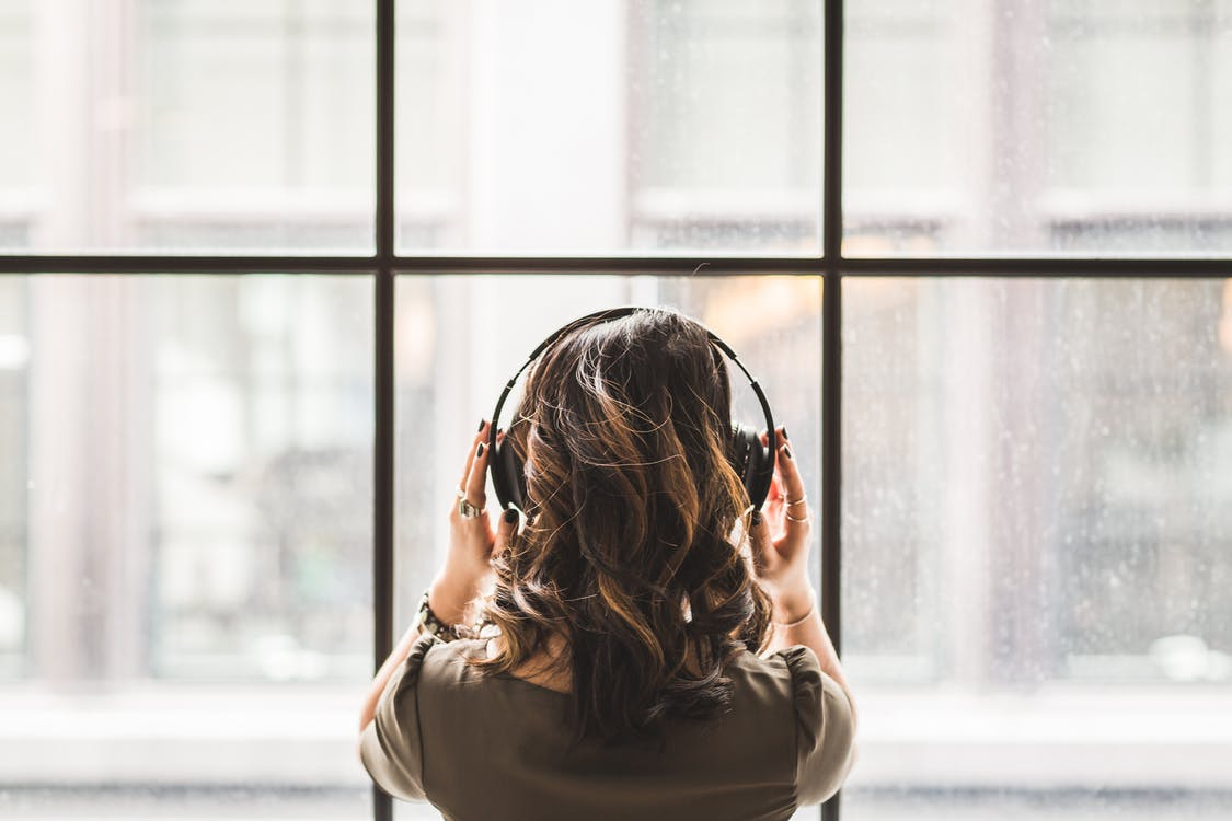 Woman Listening on Headphones