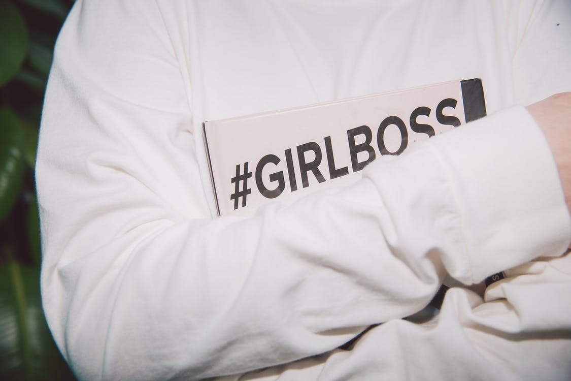 person Holding Book that says #GirlBoss