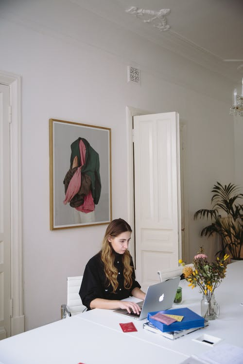 Photo Of Woman Using Laptop