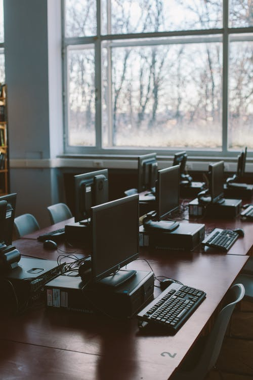 Photo Of Computers Near Windows