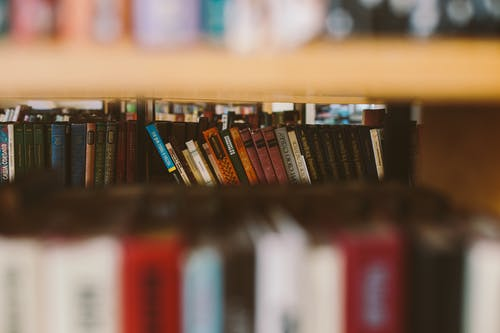 Selective Focus Photo Of Books On Bookshelf