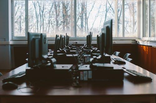 Photo Of Computers Near Window