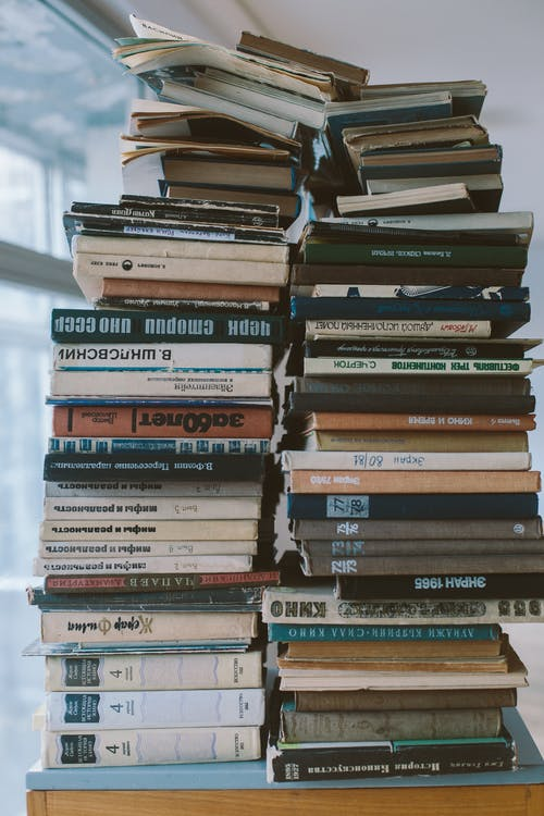 Books Piled Up on the Table
