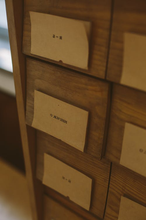 Brown Wooden Drawer With White Printer Paper
