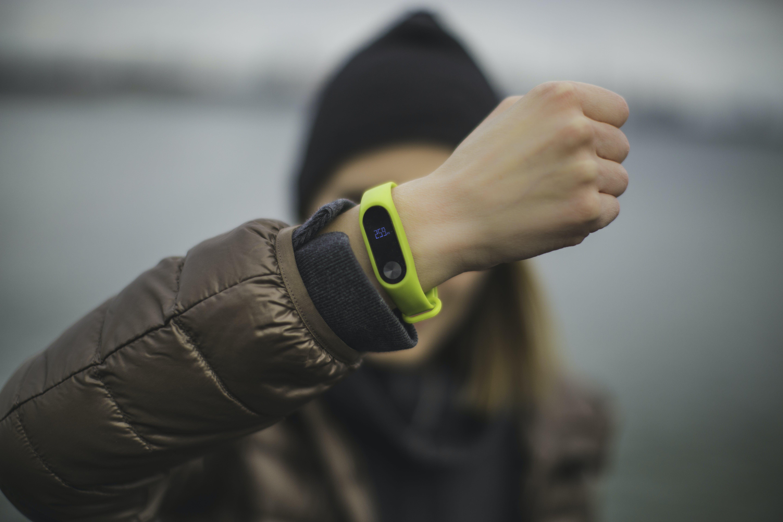 Person Wearing Green Xiaomi Band
