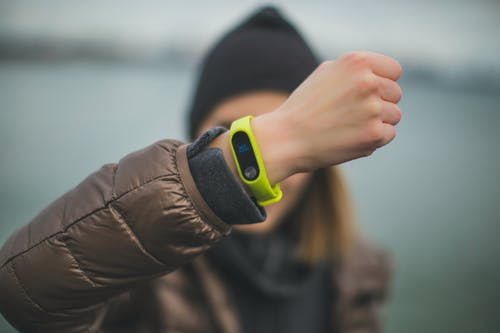 Person Wearing Green Xiaomi Band