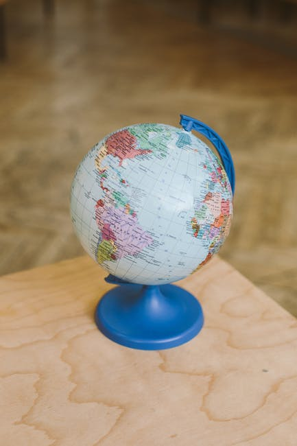 Photo of globe on top of wooden surface