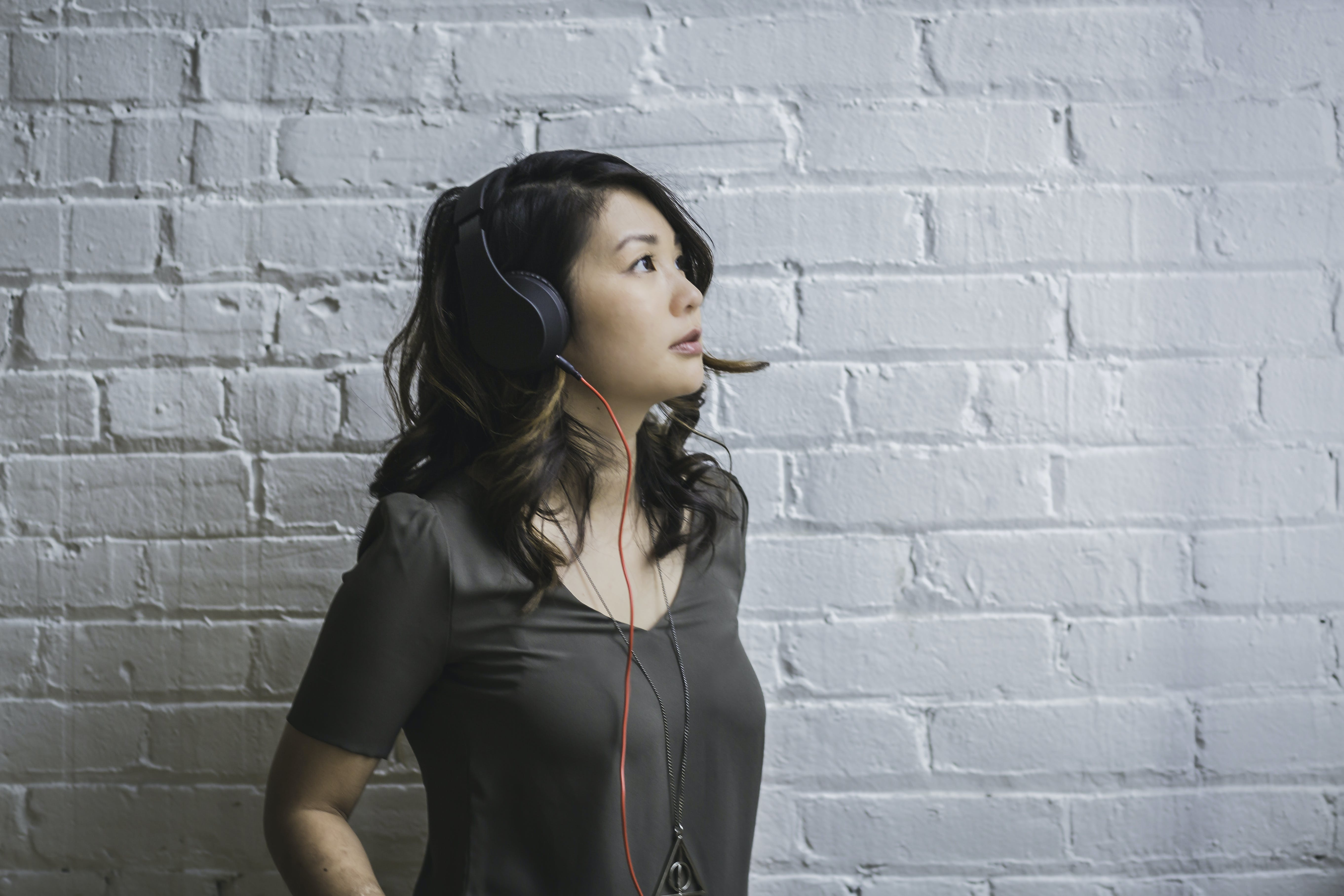 Woman Looking Up While Wearing Headphones