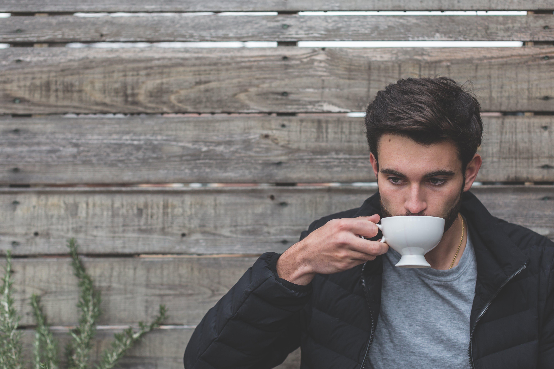 Man Holding Ceramic Teapot