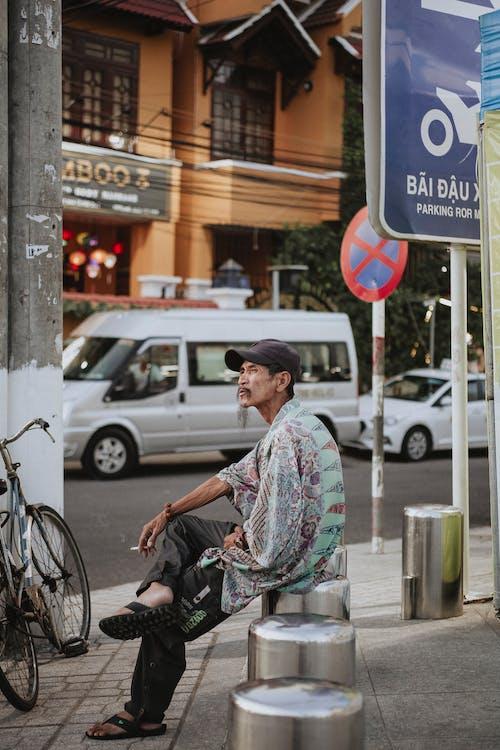 Man Sitting Outdoor Smoking