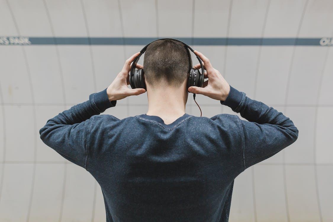 Man Wearing Gray Sweatshirt and Headphones