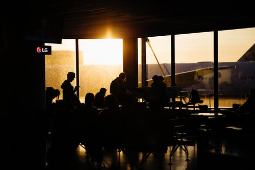 Silhouette of People Sitting Inside the Airport