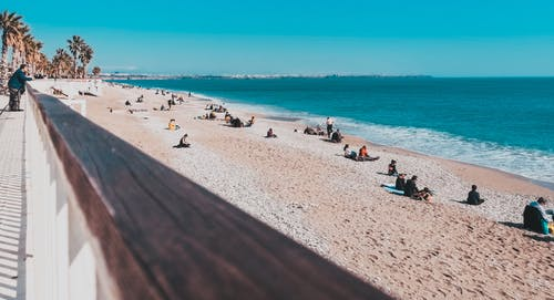 Photo Of People On Beach During Daytime