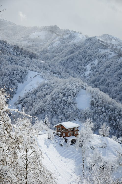 Scenic Photo Of House On Mountain