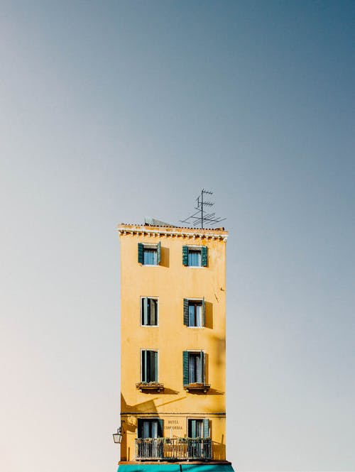 Yellow Concrete Building Under Blue Sky
