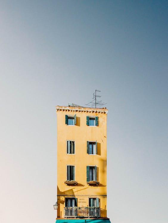Yellow Concrete Building Under Blue Sky