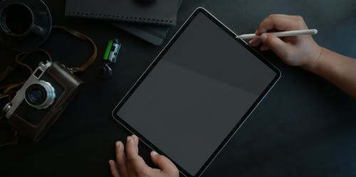 Black Ipad on Black Table
