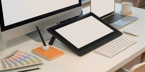 Black Framed Drawing Tablet on White Table