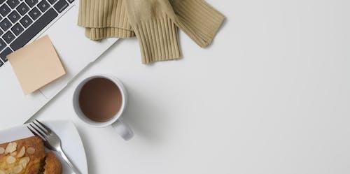 Photo Of Laptop Beside Coffee Mug