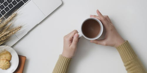 Photo Of Person Holding Cup