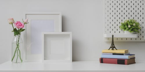 White Wooden Frame on White Table