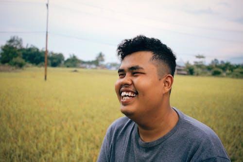 Happy Asian local man having fun in countryside