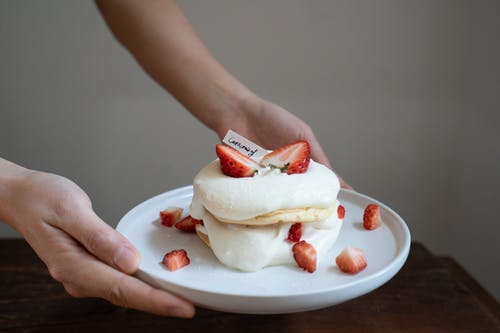 Person Holding White and Red Sandwich