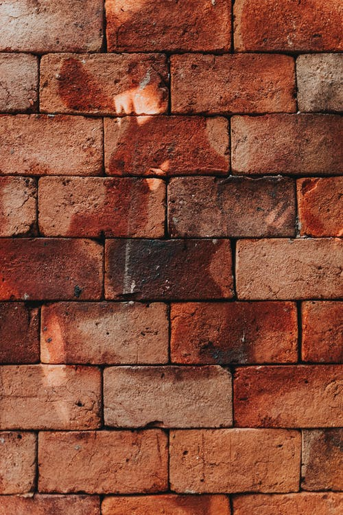 Shabby brick wall in sunny day
