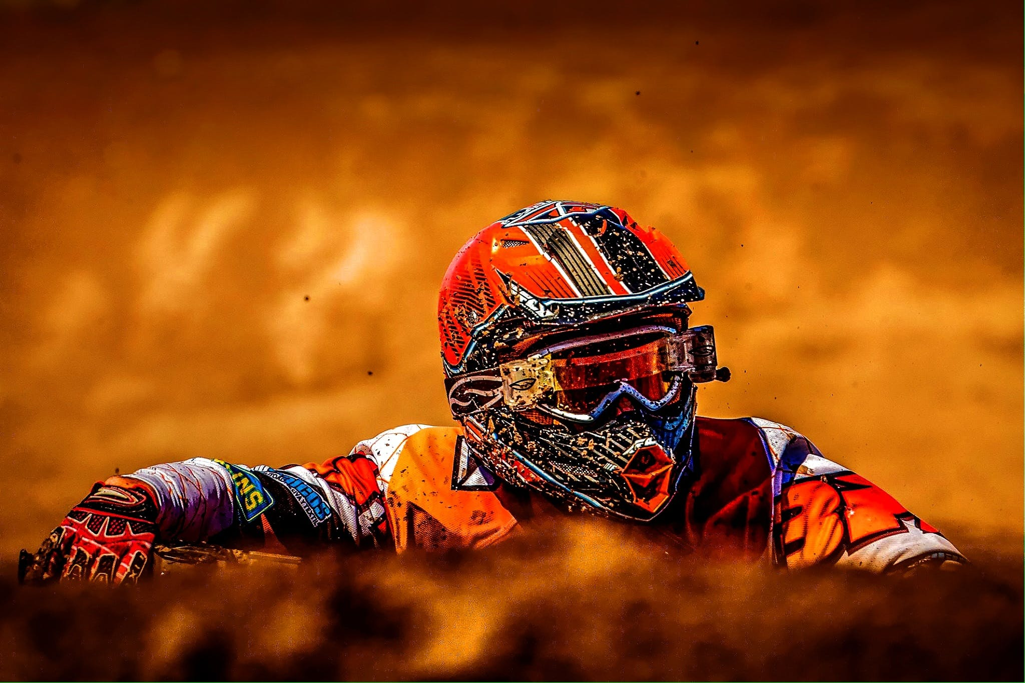 Man Wearing White Black and Orange Motorcross Suit