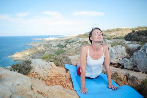 Photo Of Woman Laying On Yoga Mat