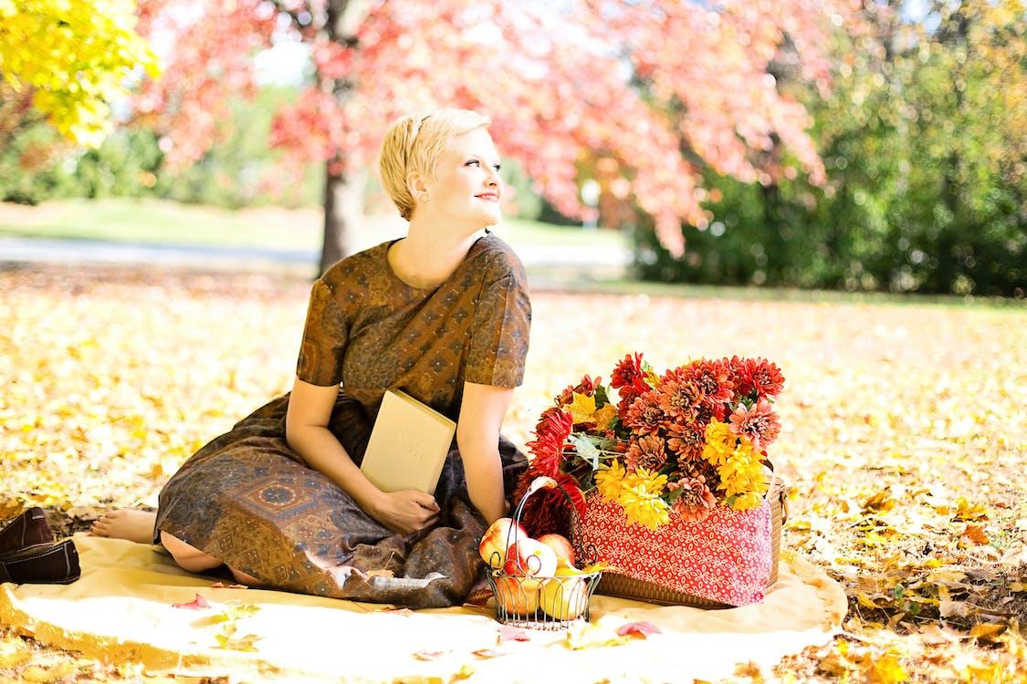 Woman Sitting Outdoor Near Tree