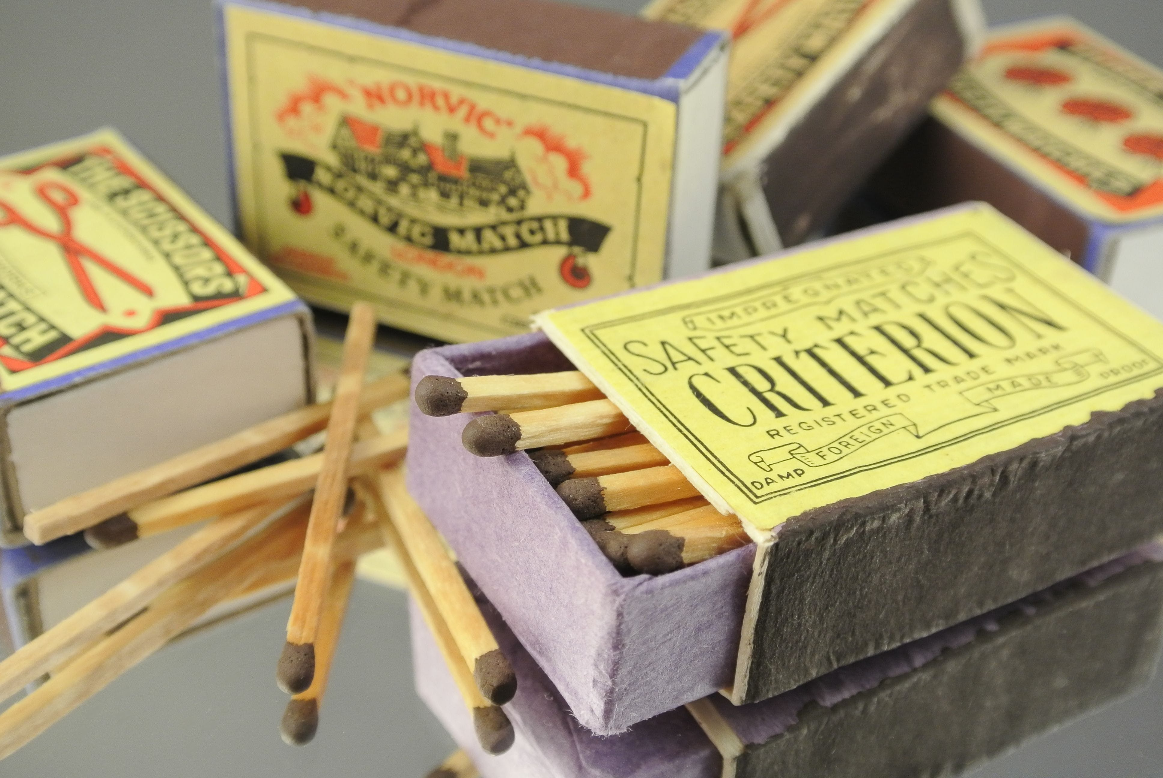 Five Safety Match Boxes on Gray Surface