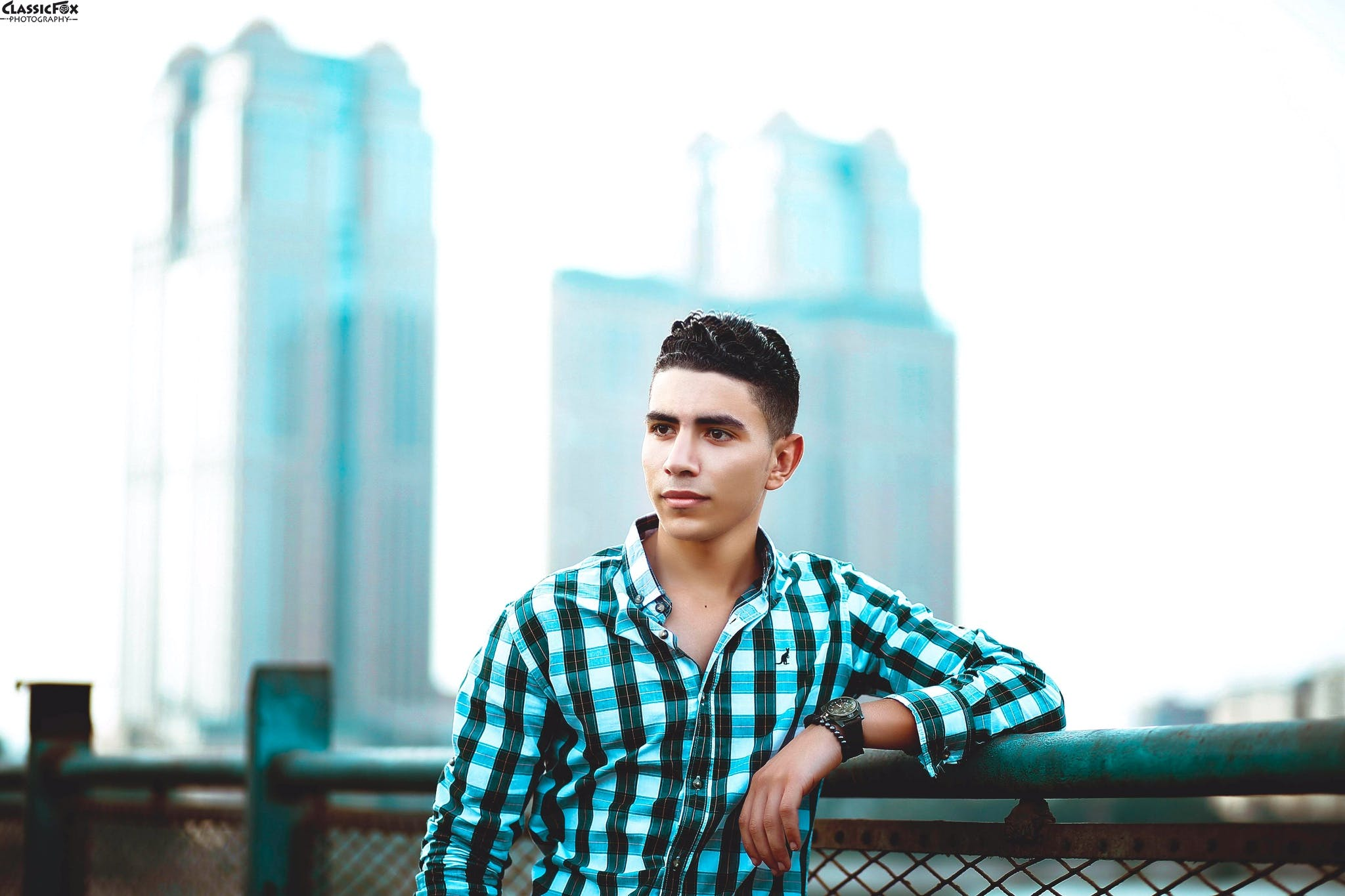 Selective Focus Photo of Man Wearing Blue and Black Sport Shirt
