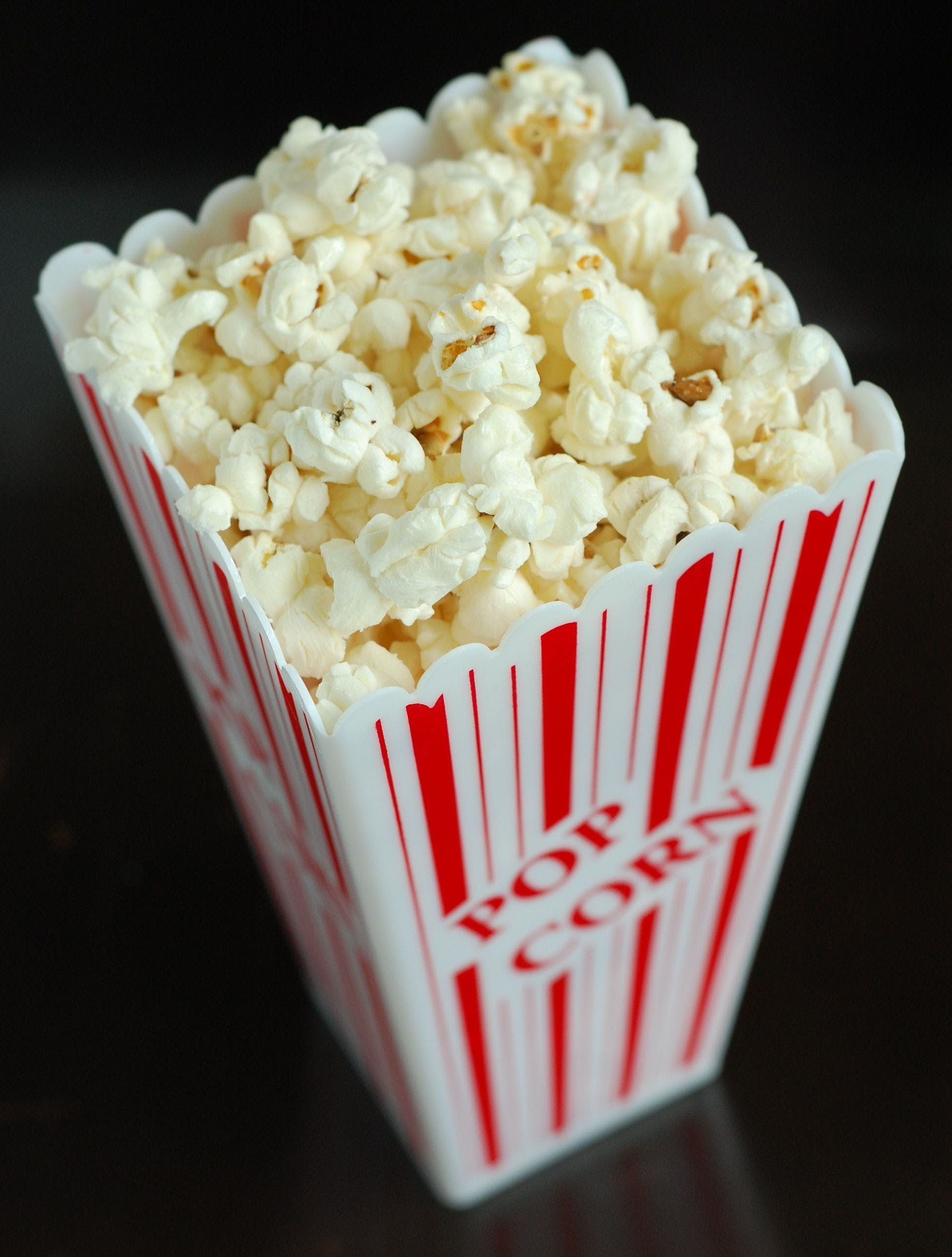 White Popcorns Inside of a Red and White Popcorn Box