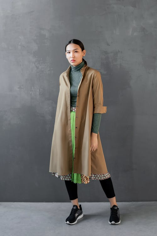 Photo Of Woman Wearing Brown Coat