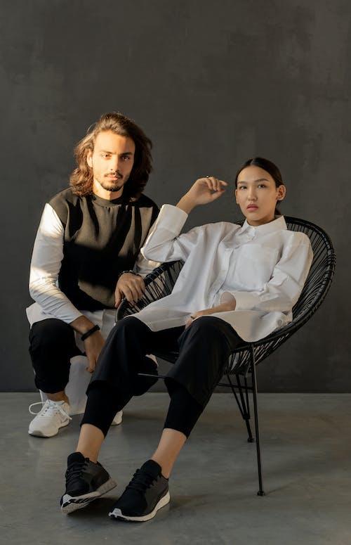 Photo Of Woman Sitting Beside Man